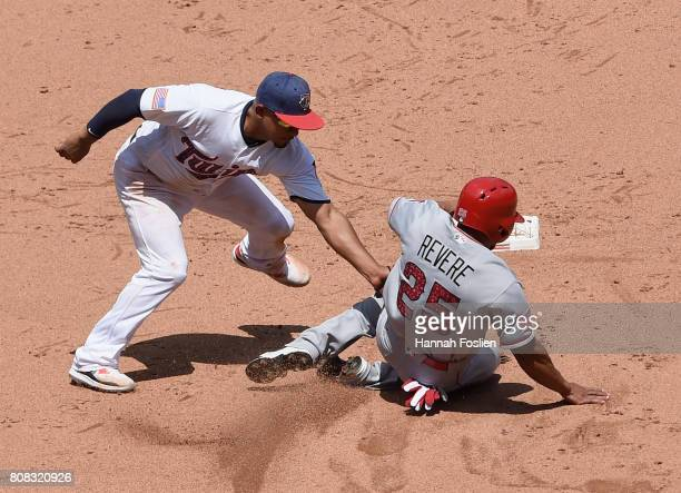 Eduardo Escobar of the Minnesota Twins catches Ben Revere of the Los Angeles Angels of Anaheim stealing second base during the fifth inning of the...