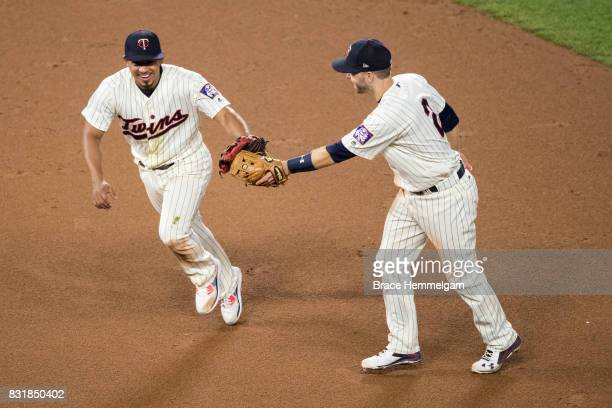 Eduardo Escobar of the Minnesota Twins celebrates with Brian Dozier against the Texas Rangers on August 5 2017 at Target Field in Minneapolis...