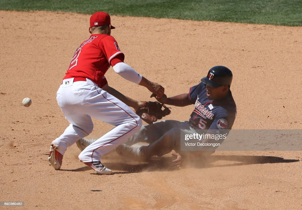 Eduardo Escobar #5 of the Minnesota Twins collides with Andrelton Simmons #2 of the Los Angeles Angels of Anaheim at second base on Escobar's steal attempt during the ninth inning of their MLB game at Angel Stadium of Anaheim on June 4, 2017 in Anaheim, California. Escobar was safe at second. The Twins defeated the Angels 3-2.