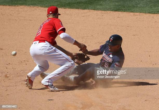Eduardo Escobar of the Minnesota Twins collides with Andrelton Simmons of the Los Angeles Angels of Anaheim at second base on Escobar's steal attempt...