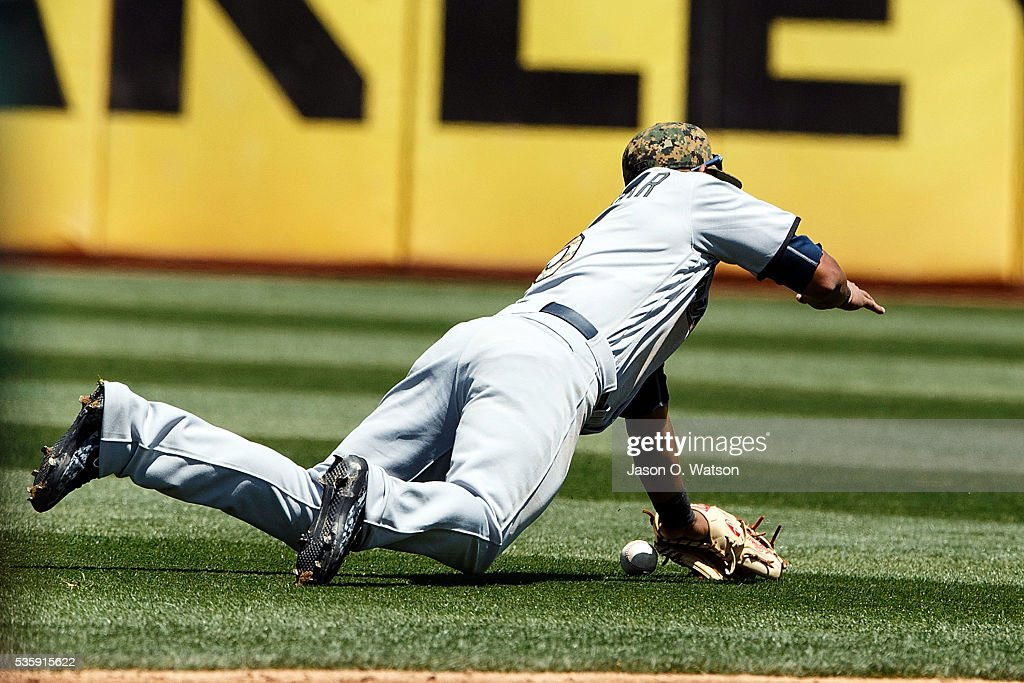 <a gi-track='captionPersonalityLinkClicked' href=/galleries/search?phrase=Eduardo+Escobar&family=editorial&specificpeople=7522733 ng-click='$event.stopPropagation()'>Eduardo Escobar</a> #5 of the Minnesota Twins dives for but is unable to catch a fly ball hit off the bat of Danny Valencia (not pictured) of the Oakland Athletics during the fourth inning at the Oakland Coliseum on May 30, 2016 in Oakland, California. The Oakland Athletics defeated the Minnesota Twins 3-2.