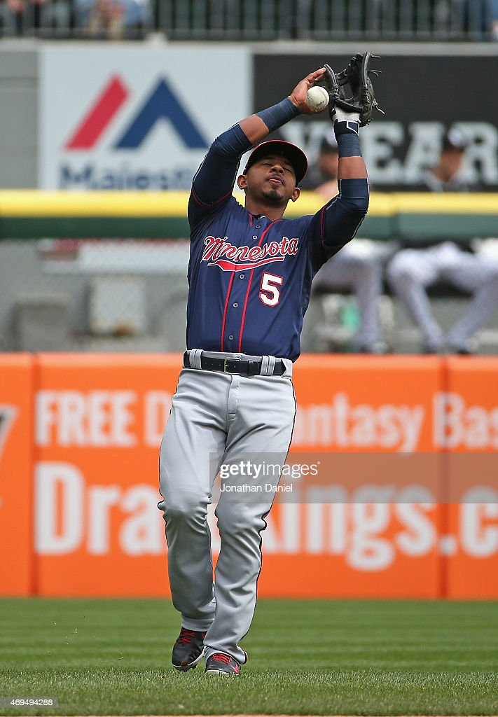 Eduardo Escobar #5 of the Minnesota Twins drops a pop-up for a fielding error in the 2nd inning against the Chicago White Sox at U.S. Cellular Field on April 12, 2015 in Chicago, Illinois.