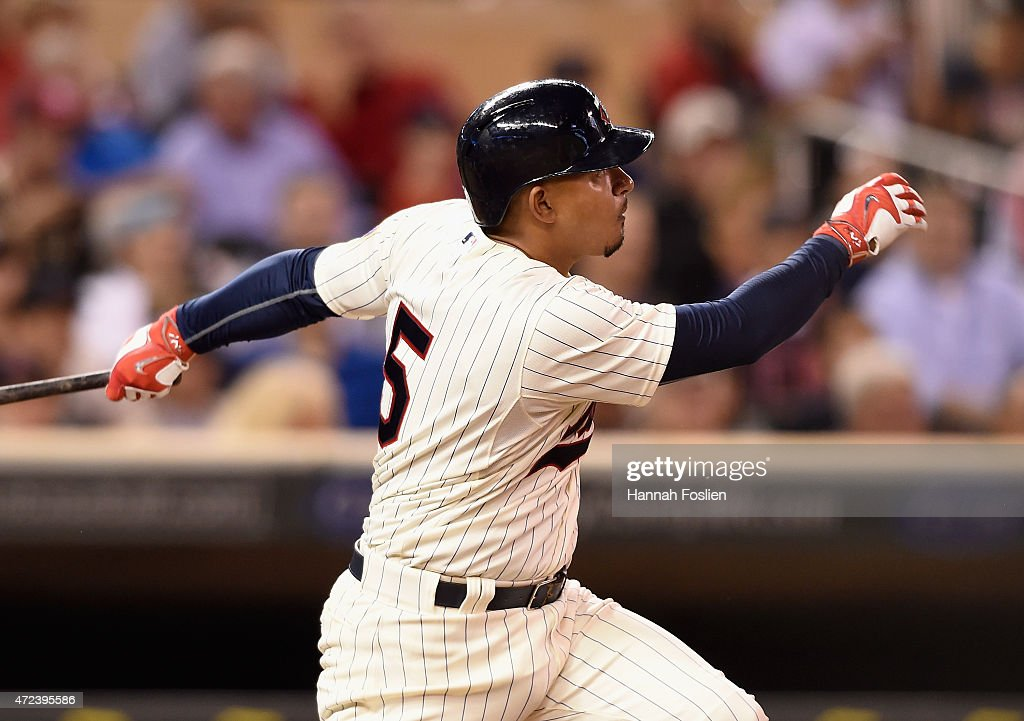 Eduardo Escobar #5 of the Minnesota Twins hits a two-run home run against the Oakland Athletics during the sixth inning of the game on May 6, 2015 at Target Field in Minneapolis, Minnesota. The Twins defeated Athletics 13-0.