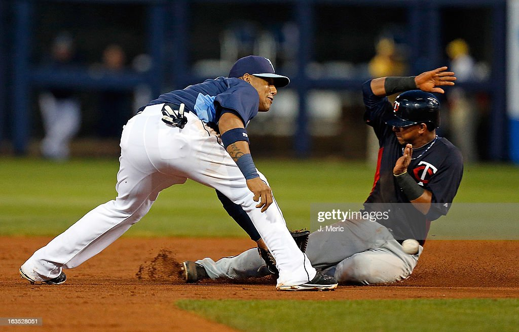 Eduardo Escobar #5 of the Minnesota Twins is caught stealing by shortstop <a gi-track='captionPersonalityLinkClicked' href=/galleries/search?phrase=Yunel+Escobar&family=editorial&specificpeople=757358 ng-click='$event.stopPropagation()'>Yunel Escobar</a> #11 of the Tampa Bay Rays during a Grapefruit League spring training game at the Charlotte Sports Complex on March 11, 2013 in Port Charlotte, Florida.