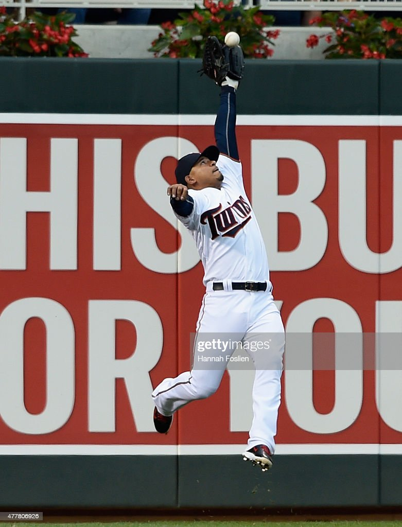 <a gi-track='captionPersonalityLinkClicked' href=/galleries/search?phrase=Eduardo+Escobar&family=editorial&specificpeople=7522733 ng-click='$event.stopPropagation()'>Eduardo Escobar</a> #5 of the Minnesota Twins makes a catch of the ball hit by Miguel Montero #47 of the Chicago Cubs in left field during the fourth inning of the game on June 19, 2015 at Target Field in Minneapolis, Minnesota.