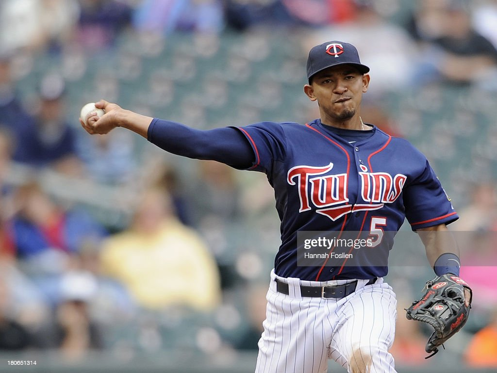<a gi-track='captionPersonalityLinkClicked' href=/galleries/search?phrase=Eduardo+Escobar&family=editorial&specificpeople=7522733 ng-click='$event.stopPropagation()'>Eduardo Escobar</a> #5 of the Minnesota Twins makes a play at third base to get out Ben Zobrist #18 of the Tampa Bay Rays at first base during the ninth inning of the game on September 15, 2013 at Target Field in Minneapolis, Minnesota. The Twins defeated the Rays 6-4.