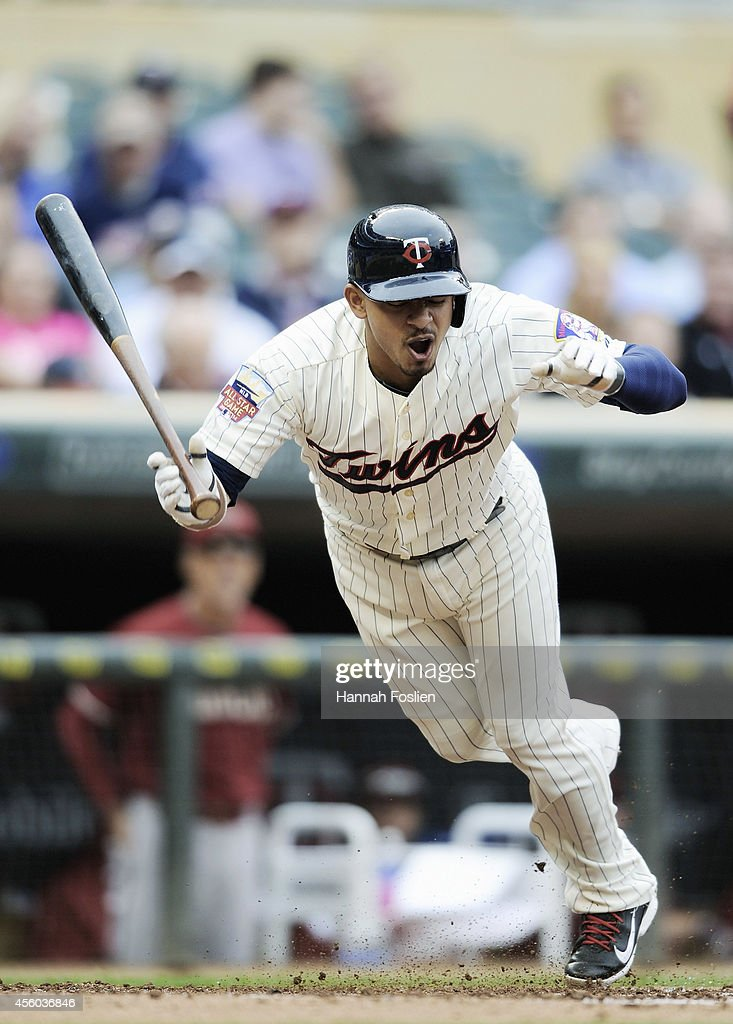 <a gi-track='captionPersonalityLinkClicked' href=/galleries/search?phrase=Eduardo+Escobar&family=editorial&specificpeople=7522733 ng-click='$event.stopPropagation()'>Eduardo Escobar</a> #5 of the Minnesota Twins reacts to being hit in the foot by a pitch during the second inning of the game against the Arizona Diamondbacks on September 24, 2014 at Target Field in Minneapolis, Minnesota.