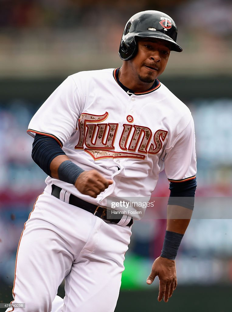 Eduardo Escobar #5 of the Minnesota Twins rounds third base on his way to scoring a run against the Boston Red Sox during the second inning of the game on May 25, 2015 at Target Field in Minneapolis, Minnesota. The Twins defeated the Red Sox 7-2.