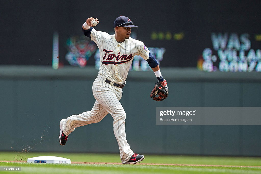 <a gi-track='captionPersonalityLinkClicked' href=/galleries/search?phrase=Eduardo+Escobar&family=editorial&specificpeople=7522733 ng-click='$event.stopPropagation()'>Eduardo Escobar</a> #5 of the Minnesota Twins throws against the New York Yankees on July 5, 2014 at Target Field in Minneapolis, Minnesota. The Twins defeated the Yankees 2-1.