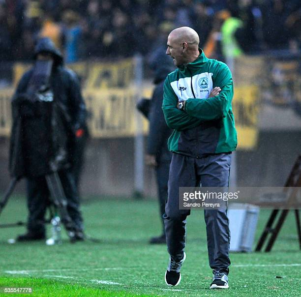 Eduardo Espinel coach of Plaza Colonia walks on the sideline during a match between Penarol and Plaza Colonia as part of Campeonato Uruguayo at...