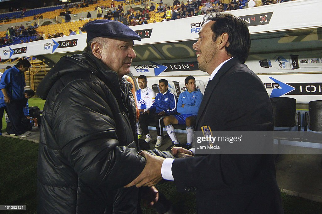 Eduardo Fentanes (R), coach of San Luis greets with Manuel Lapuente (L), coach of Puebla during a match between San Luis and Puebla as part of the Clausura 2013 Liga MX at Alfonso Lastras Stadium on February 09, 2013 in San Luis Potosi, Mexico.