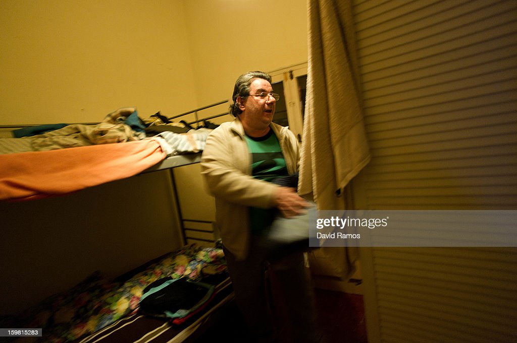 Eduardo from Spain, 54, folds his cloth in his shared room of the apartment rent by Wolfgang Striebinger for giving a bed to the volunteers of the 'El Chiringuito de Dios' ('the Stall of God') on January 14, 2013 in Barcelona, Spain. The German pastor Wolfgang Striebinger has lived in Barcelona since 1991, originally employed to minister to youths during the Barcelona Olympic Games, he decided to stay and since 2000 has run 'El Chinguito de Dios' (The Stall of God). In his mission to support the homeless, Wolfgang and his volunteers offer a place for up to 200 people to come and have some food daily and also offering them assistance with grooming and clothes. Many of the volunteers are homeless and help out in return for meals and a bed. Wolfgang's ethos is to provide peace, calm and dignity to all those that need it amongst Barcelona's burgeoning homeless population. Due to the economic situation his doors are now also open to the long term unemployed and families with little or no income. According to the latest figures 21.8% of the Spanish populations are living below the poverty line.