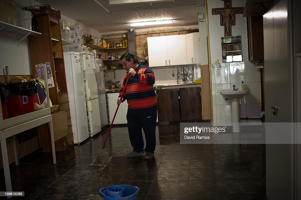Eduardo from Spain, 54, sweeps the floor at the 'El Chiringuito de Dios', after serving the breakfast to needy people on January 4, 2013 in Barcelona, Spain. The German pastor Wolfgang Striebinger has lived in Barcelona since 1991, originally employed to minister to youths during the Barcelona Olympic Games, he decided to stay and since 2000 has run 'El Chinguito de Dios' (The Stall of God). In his mission to support the homeless, Wolfgang and his volunteers offer a place for up to 200 people to come and have some food daily and also offering them assistance with grooming and clothes. Many of the volunteers are homeless and help out in return for meals and a bed. Wolfgang's ethos is to provide peace, calm and dignity to all those that need it amongst Barcelona's burgeoning homeless population. Due to the economic situation his doors are now also open to the long term unemployed and families with little or no income. According to the latest figures 21.8% of the Spanish populations are living below the poverty line.