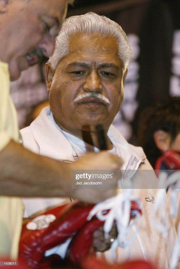Eduardo Garcia, trainer of Fernando Vargas looks on after the weigh-ins for the World Super Welterweight/Jr. Middleweight Championship fight between Oscar De La Hoya and Vargas at the Mandalay Bay Events Center on September 13, 2002 in Las Vegas, Nevada.