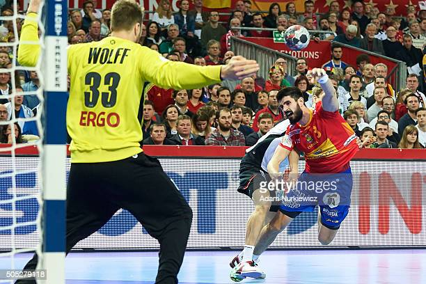 Eduardo Gurbindo of Spain throws against goalkeeper Andreas Wolff of Germany during the Men's EHF Handball European Championship 2016 match between...