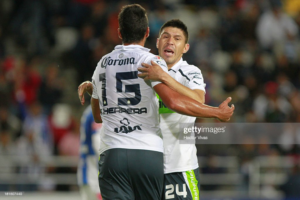 Eduardo Herrera and Oribe Peralta of Santos celebrates after a scoring goal during a match between Pachuca and Santos as part of the Liga MX at Hidalgo stadium on September 21, 2013 in Pachuca, Mexico.