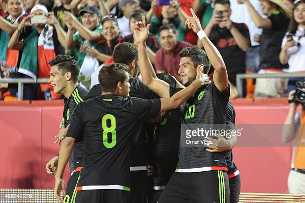 Eduardo Herrera of Mexico celebrates with teammates after scoring the first goal during an international friendly match between Paraguay and Mexico...