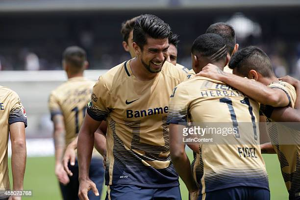 Eduardo Herrera of Pumas celebrates after scoring during an 8th round match between Pumas UNAM and Veracruz as part of the Apertura 2015 Liga MX at...