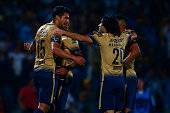 Eduardo Herrera of Pumas celebrates with teammates after scoring the first goal of his team during the match between Pumas UNAM and Deportivo Tachira...