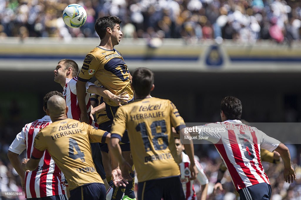 Eduardo Herrera of Pumas struggles for the ball during a match between Pumas and Chivas as part of Clausura 2013 Liga MX at Olympic Stadium on March 03, 2013 in Mexico City, Mexico.