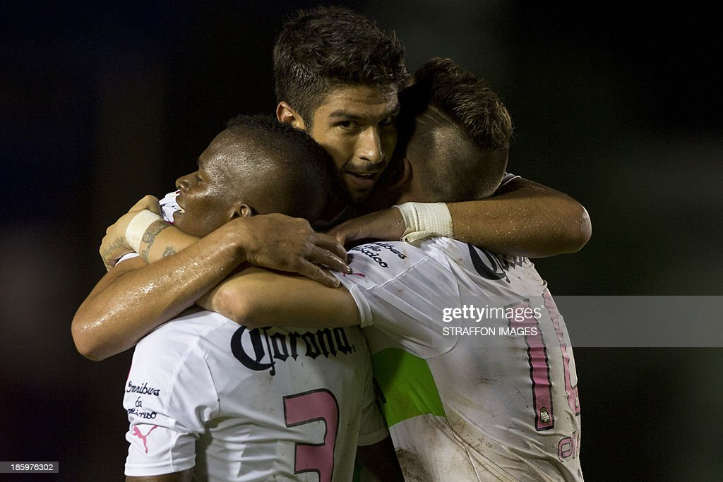 Eduardo Herrera of Santos celebrates his second goal with Mauro Cejas and Darwin Quintero during a match between Atlante and Santos Laguna as part of the Apertura 2013 Liga MX at Olympic Stadium Andres Quintana Roo on October 26, 2013 in Cancun, Mexico.