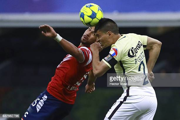 Eduardo Herrera of Veracruz struggles for the ball with Paolo Goltz of America during the 4th round match between America and Veracruz as part of the...