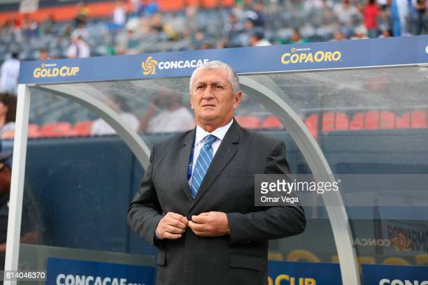 Eduardo Lara coach of El Salvador looks on prior to the CONCACAF Gold Cup Group C match between El Salvador and Curacao at Sports Authority Field on...