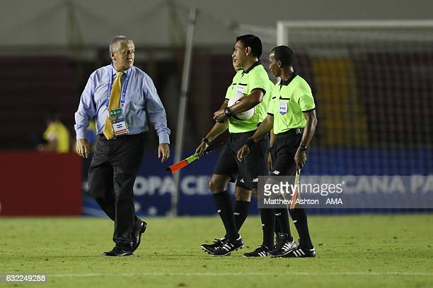 Eduardo Lara the head coach / manager of El Salvador questions the officials about the sending off of Richard Menivar in the first half during the...