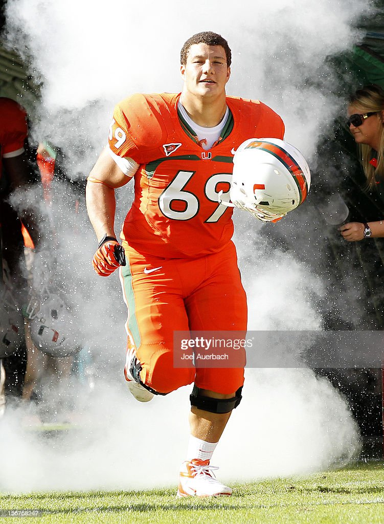 Eduardo Lopez #69 of the Miami Hurricanes is introduced to the crowd during senior day prior to the game against the South Florida Bulls on November 17, 2012 at Sun Life Stadium in Miami Gardens, Florida. The Hurricanes defeated the Bulls 40-9.