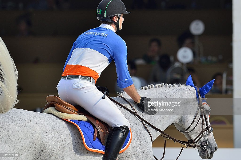 Eduardo Menezes of Brazil hiding Caruschka 2 during the Global Champions League Team Competition, second round on May 1, 2016 in Shanghai, China.