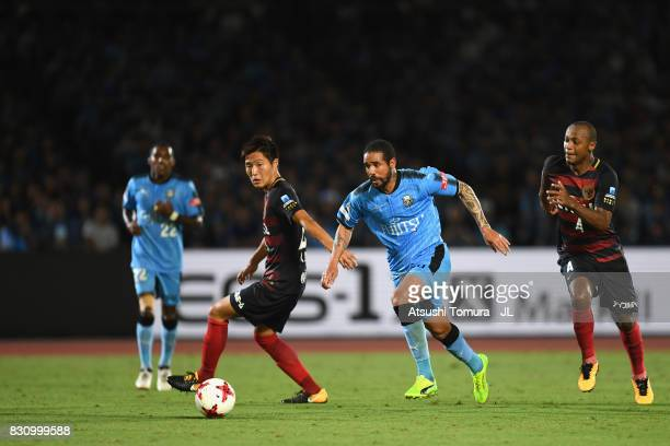 Eduardo Neto of Kawasaki Frontale and Kento Misao of Kashima Antlers compete for the ball during during the JLeague J1 match between Kawasaki...