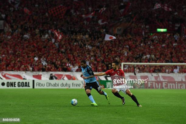 Eduardo Neto of Kawasaki Frontale and Zlatan of Urawa Red Diamonds compete for the ball during the AFC Champions League quarter final second leg...