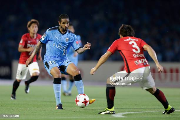 Eduardo Neto of Kawasaki Frontale takes on Tomoya Ugajin of Urawa Red Diamonds during the JLeague J1 match between Kawasaki Frontale and Urawa Red...