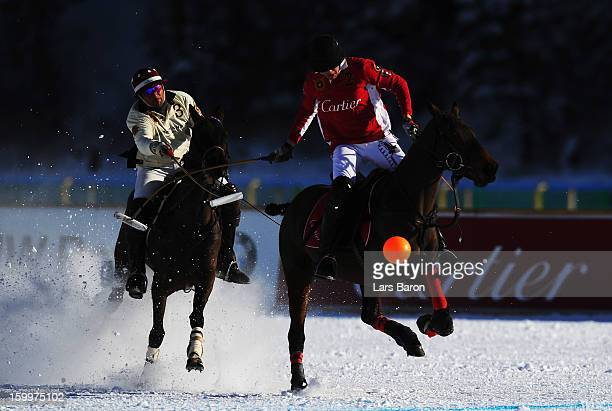 Eduardo Novillo Astrada of Great Britain and SAL Oppenheim challenges Max Charlton of Great Britain and Cartier during the Polo World Cup on Snow...