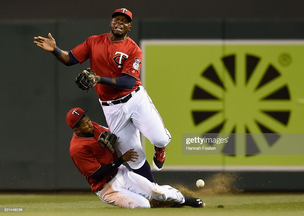 <a gi-track='captionPersonalityLinkClicked' href=/galleries/search?phrase=Eduardo+Nunez&family=editorial&specificpeople=4900197 ng-click='$event.stopPropagation()'>Eduardo Nunez</a> and Miguel Sano of the Minnesota Twins collide in right field going after a ball hit by Yunel Escobar of the Los Angeles Angels of Anaheim during the fourth inning of the game on April 15, 2016 at Target Field in Minneapolis, Minnesota. All players are wearing number 42 in honor of Jackie Robinson Day.