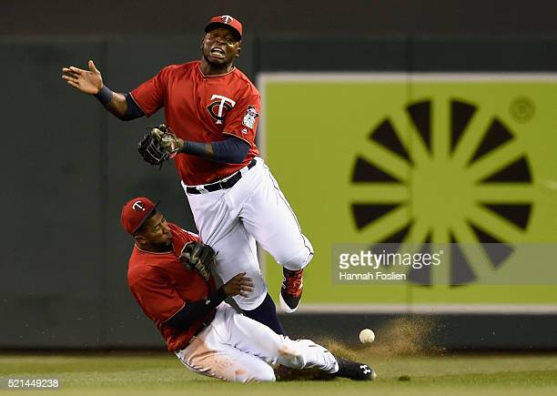 Eduardo Nunez and Miguel Sano of the Minnesota Twins collide in right field going after a ball hit by Yunel Escobar of the Los Angeles Angels of...