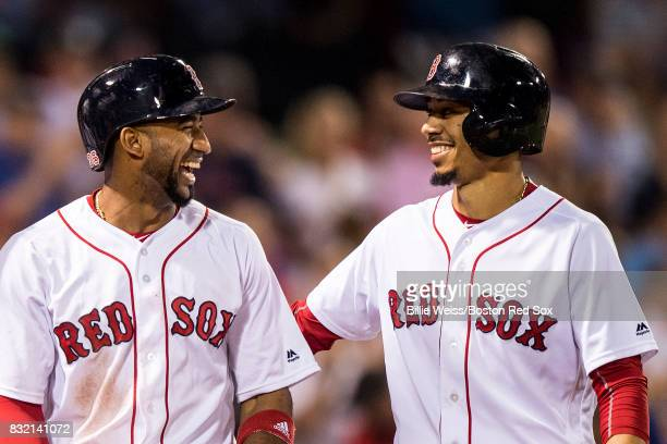 Eduardo Nunez and Mookie Betts of the Boston Red Sox react after scoring during the fourth inning of a game against the St Louis Cardinals on August...