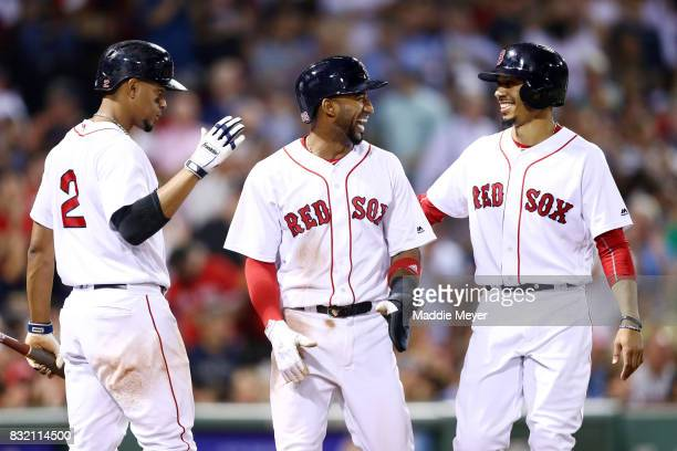 Eduardo Nunez of the Boston Red Sox and Mookie Betts celebrate with Xander Bogaerts after Betts and Nunez scored runs against the St Louis Cardinals...