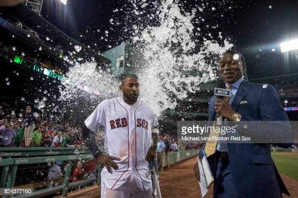 Eduardo Nunez of the Boston Red Sox and NESN broadcaster Jahmai Webster are doused in water after Nunez's twohome run game lead the Red Sox to a 98...