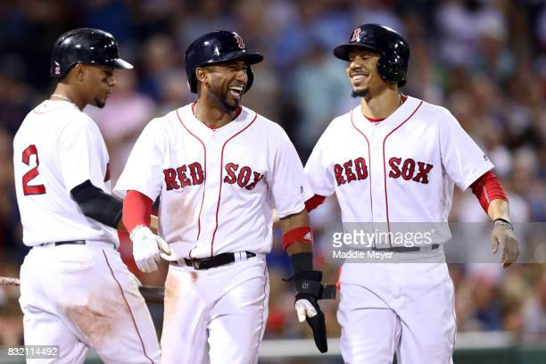 Eduardo Nunez of the Boston Red Sox celebrates with Mookie Betts after they scored runs against the St Louis Cardinals during the fifth inning at...