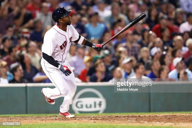 Eduardo Nunez of the Boston Red Sox hits a double during the sixth inning against the Boston Red Sox at Fenway Park on August 1 2017 in Boston...