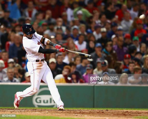 Eduardo Nunez of the Boston Red Sox hits a home run in the bottom of the third inning during the game against the Kansas City Royals at Fenway Park...