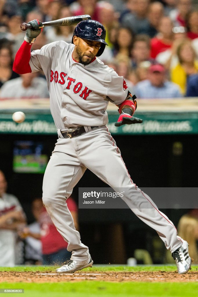 Eduardo Nunez #36 of the Boston Red Sox is hit by a pitch during the eighth inning against the Cleveland Indians at Progressive Field on August 23, 2017 in Cleveland, Ohio.
