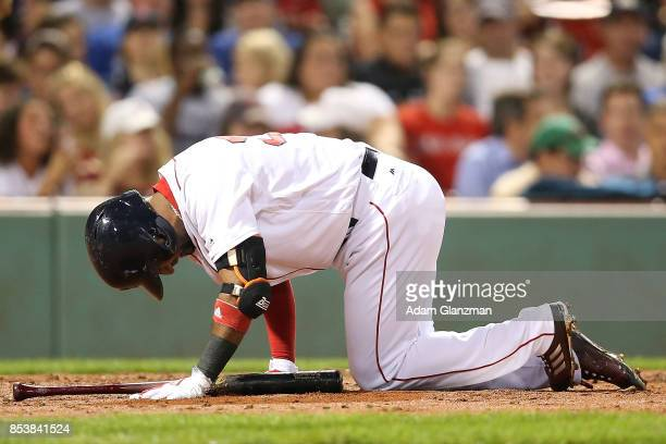 Eduardo Nunez of the Boston Red Sox is injured during an at bat in the fourth inning of a game against the Toronto Blue Jays at Fenway Park on...