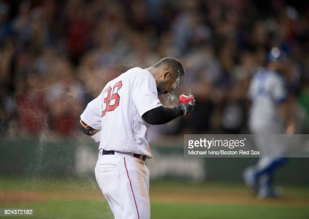Eduardo Nunez of the Boston Red Sox reacts after being doused with flour during a walkoff celebration following the Red Sox 98 win over the Kansas...
