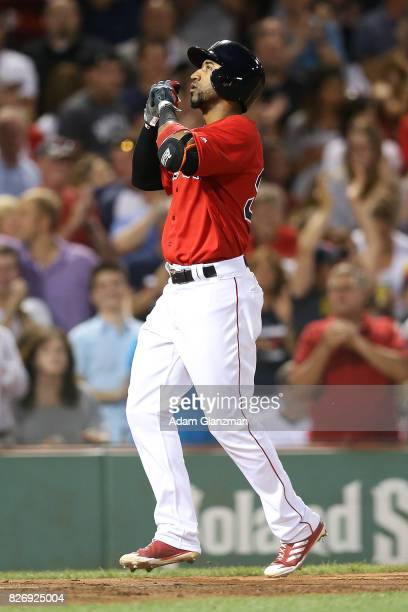 Eduardo Nunez of the Boston Red Sox reacts as he crosses home plate after hitting a solo home run in the sixth inning of a game against the Chicago...