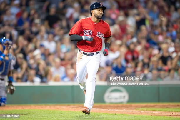 Eduardo Nunez of the Boston Red Sox rounds first base after hitting a single during the fifth inning of a game against the Kansas City Royals on July...