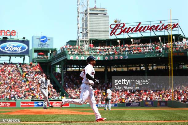 Eduardo Nunez of the Boston Red Sox rounds the bases after hitting a solo home run in the first inning of a game against the Chicago White Sox at...