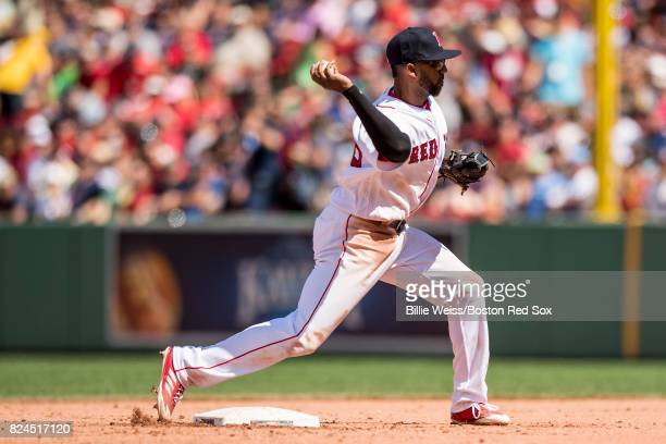 Eduardo Nunez of the Boston Red Sox turns a double play during the fourth inning of a game against the Kansas City Royals on July 30 2017 at Fenway...