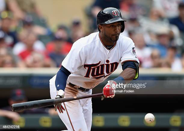 Eduardo Nunez of the Minnesota Twins hits an RBI bunt single against the Cleveland Indians during the eighth inning of the game on August 16 2015 at...